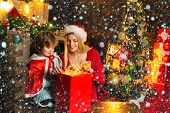 Family Holiday. Cozy Evening At Home. Mom And Kid Play Together Christmas Eve. Happy Family. Mother  poster