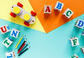Wooden Kids Toys On Colourful Paper. Educational Toys Blocks, Pyramid, Pencils, Numbers, Train. Toys poster