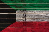 National Flag  Of Kuwait On A Wooden Wall Background. The Concept Of National Pride And A Symbol Of  poster