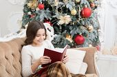 Book To Read Over Winter Break. Happy Book Reader. Small Child Read Christmas Book. Little Girl Enjo poster
