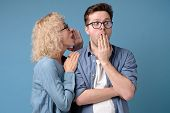 Secret, Gossip Concept. Mature Woman Whispering A Secret To Young Man poster
