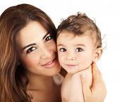 Cute baby boy smiling with mother, closeup on happy family faces, mom and kid having fun indoor, par