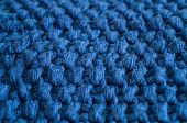 Warm Knitted Dark Blue Background. Knitted Clothes, Sweaters, Knitwear, Space For Text. Autumn Winte poster