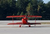 picture of aerobatics  - Small light aerobatic airplane painted red front view - JPG