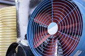 New Ventilation Fan. Theres Wire Protection In Front Of The Propeller. The Wings Are Red In Blue. poster