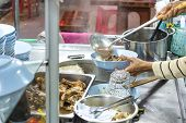 Cooker Making Thai Noodle Of Jumbo Beef Ball With Meaty Sell On Cart At Night. Thai Street Food. Tha poster