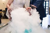 Bride And Groom Make A Cocktail Of Dry Ice, Alcohol And Juice, Glass With The Effect Of Dry Ice,blue poster