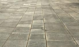 stock photo of stone floor  - big stones floor promenade perspective on horizontal view  - JPG