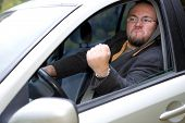 image of angry man  - photo of angry man driving by car