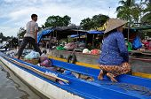 Vietnamese sellers at Can Tho floating market, Mekong Delta, Vietnam