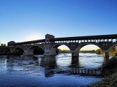 stock photo of carthusian  - Ponte Coperto bridge in Pavia Lombardy Italy - JPG