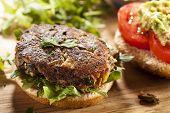 stock photo of veggie burger  - Homemade Organic Vegetarian Mushroom Burger with tomato and guacamole - JPG