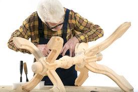 foto of woodcarving  - Old woodcarver work in the workshop - JPG