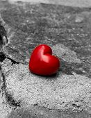 stock photo of lost love  - lonely red heart on a road symbol of loneliness lost love - JPG