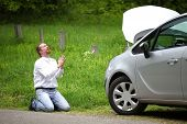 picture of praying  - Funny driver praying a broken car by the road - JPG
