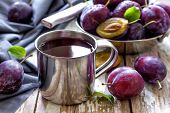 pic of fruit-juice  - Fresh plum juice and fruits with leaves