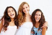 image of 15 year old  - Portrait Of Three Teenage Girls Leaning Against Wall - JPG
