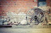 stock photo of ox wagon  - Old carriage wheel built into the wall - JPG