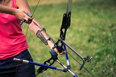 stock photo of longbow  - Selective focus on the lovely young fair - JPG