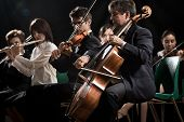 pic of flute  - Symphony orchestra on stage violins cello and flute performing - JPG
