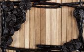 stock photo of licorice  - a wooden background with wheels and sticks of licorice - JPG