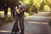 stock photo of say goodbye  - Family and soldier in a military uniform say goodbye before a separation