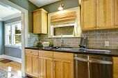 stock photo of sink  - Maple kitchen cabinets with tile back splash trim built - JPG
