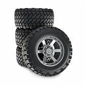 stock photo of four-wheel  - 3d illustration of stack of offroad wheels - JPG