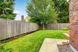 stock photo of wooden fence  - Backyard with wooden fence and walkway - JPG