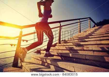 sound way of life games lady running up on stone stairs dawn ocean side