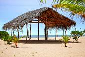pic of canopy roof  - Canopy of straw on an empty beach - JPG