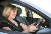 pic of driving  - Lifestyle photo of attractive senior woman driving car - JPG
