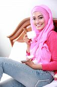 image of muslimah  - portrait of young muslim woman had a cup of tea for breakfast - JPG