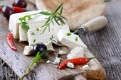 stock photo of fresh slice bread  - Greek snack with feta cheese - JPG