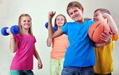 picture of dumbbell  - Team portrait of sportive kids friends with dumbbells and ball - JPG