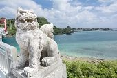 picture of guardian  - Japanese traditionally guardian lion sculpture near the sea - JPG