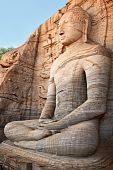 stock photo of vihara  - Ancient sitting Buddha image Gal Vihara Polonnaruwa Sri Lanka - JPG