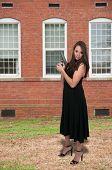 stock photo of handgun  - Beautiful woman with a loaded handgun pistol - JPG
