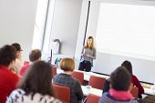 stock photo of speaker  - Speaker giving presentation in lecture hall at university - JPG