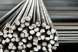 stock photo of rod  - Closeup of Steel Rods or Bars, to Reinforce Concrete, Stacked Together ** Note: Shallow depth of field - JPG
