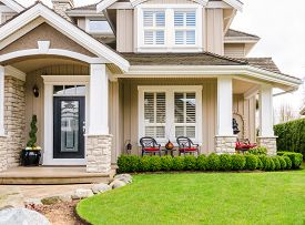 picture of in front  - Entrance of a luxury house with a patio on a bright - JPG