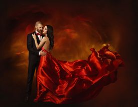 picture of flutter  - Elegant Couple Dancing in Love Woman in Red Clothes and Lover Man in Classic Suit Long Waving Dress Tail Fashion Beauty Portrait - JPG