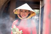 picture of conic  - Portrait of smiling beautiful Vietnamese woman wearing conical hat - JPG