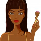 stock photo of blush  - Attractive african woman with dark brown skin applying makeup blush - JPG