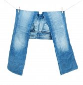 foto of peg-leg  - Blue Jeans On Washing Line Isolated On White  - JPG