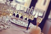 stock photo of wedding feast  - Glasses filled with campagne on wedding day - JPG