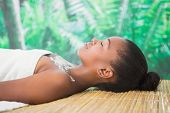 image of chest hair  - Pretty woman lying on massage table with salt scrub on the chest - JPG