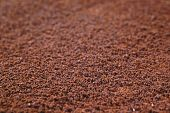 foto of coffee grounds  - freshly ground roasted coffee backgrounds  - JPG