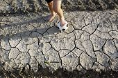 stock photo of barefoot  - A barefoot boy wants to play football - JPG