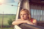 pic of campervan  - Beautiful young woman sitting in a camper van on a summer day - JPG